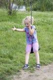 Little girl swinging Stock Photography
