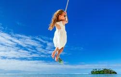 Little girl swinging Royalty Free Stock Image