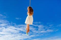 Little girl swinging Stock Photos