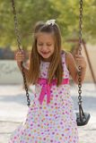 Little Girl Swinging In The Park Royalty Free Stock Photo
