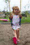 Little Girl Swinging after a Meal Stock Photography