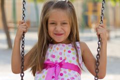 Little girl swinging in the park Royalty Free Stock Photos