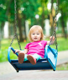 Little girl swinging on playground Royalty Free Stock Photo