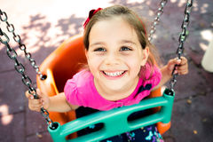 Little Girl Swinging At Playground Outdoors Stock Photography