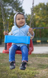 Little girl swinging. Little girl playing on swing royalty free stock photo