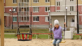 Little girl swinging stock video footage
