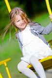 Little girl is swinging Royalty Free Stock Photos