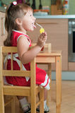 A little girl at a table Royalty Free Stock Photography