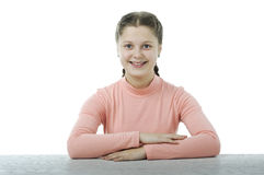Little girl at the table in school on white Royalty Free Stock Photo
