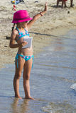 Little girl with tablet on beach during summer vacation Royalty Free Stock Photography