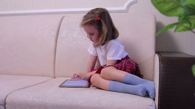 Little girl with tablet compute medium shot stock video