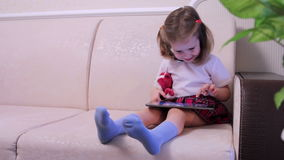 Little girl with tablet compute medium shot stock footage