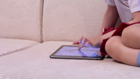 Little girl with tablet computer stock footage