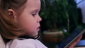 Little girl with tablet computer сloseup stock video