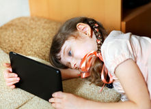 Little Girl with Tablet Royalty Free Stock Photos