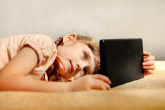 Little Girl with Tablet Royalty Free Stock Image