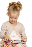 Little girl with tablet gadget isolated white background Royalty Free Stock Images
