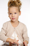 Little girl with tablet gadget isolated white background Stock Photos