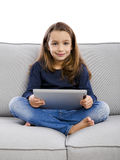 Little girl with a tablet Royalty Free Stock Photo