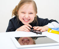 Little girl with tablet PC computer. Picture of happy little girl with tablet PC computer Royalty Free Stock Photo