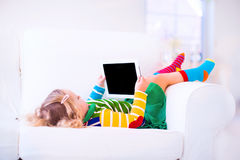 Little girl with tablet pc Royalty Free Stock Photo