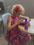 Little girl with tablet pc and headphones royalty free stock images