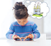 Little girl with tablet pc at home Stock Photo