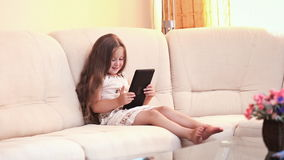 Little girl with the tablet stock video footage