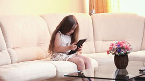 Little girl with the tablet stock footage