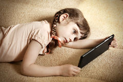 Little Girl with Tablet Royalty Free Stock Images