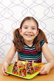 Little girl with tacos Stock Images