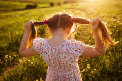 Little girl with tails of hair Stock Photo