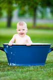 Little girl take a bath in vintage tube Royalty Free Stock Photo