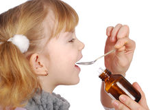 Little girl take medicine Royalty Free Stock Photography