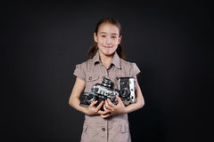 Little girl take photo with vintage camera at black background Royalty Free Stock Photo