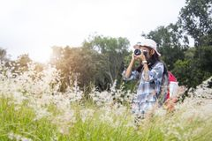 Little girl take pictures in tourism. Backpack travel Stock Photography