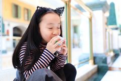 Little girl With Takeout Drink Royalty Free Stock Photography