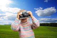 Little girl takes photo of nature Stock Photography