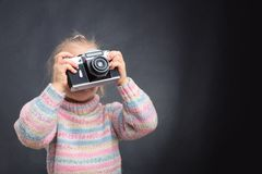 Little girl takes photo of nature Royalty Free Stock Image