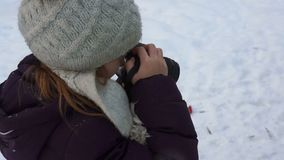 Little girl takes photos in winter stock video