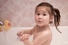 Little girl taking bath Stock Image