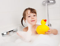 Little girl taking a bath Stock Image