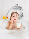 Little girl taking a bath stock photo