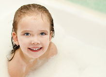 Little girl is taking a bath Stock Images