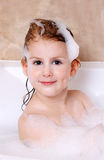 Little girl is taking a bath. With a foam Royalty Free Stock Photography