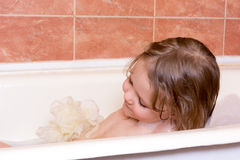 Little girl taking bath with foam Royalty Free Stock Photos