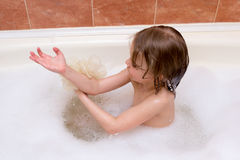 Little girl taking bath with foam Royalty Free Stock Image