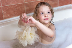 Little girl taking bath with foam Stock Photo