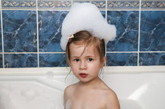 Little girl taking a bubble bath. Healthcare and hygiene concept Royalty Free Stock Photos