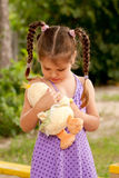 Little girl taking care of toy. Stock Photography